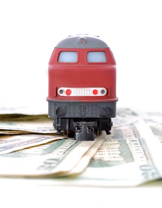 Toy train on money